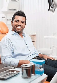 Patient Smiling in Dental Chair